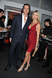 CAPRICE BOURRET and TY COMFORT at the inaugural Gabrielle's Gala in London in aid of Gabrielle's Angel Foundation for Cancer Research held at Battersea Power Station, London on 7th June 2012.