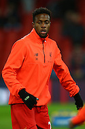 Divock Origi of Liverpool warming up prior to kick off. Premier League match, Liverpool v West Ham Utd at the Anfield stadium in Liverpool, Merseyside on Sunday 11th December 2016.<br /> pic by Chris Stading, Andrew Orchard sports photography.