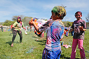 Children spray eachother with water guns as more than 1,500 participants throw colored powder on each other to celebrate the end of Winter and beginning of Spring during Holi, a Hindu Festival of Colors, at Cardoza Park in Milpitas, California, on March 23, 2013. (Stan Olszewski/SOSKIphoto)