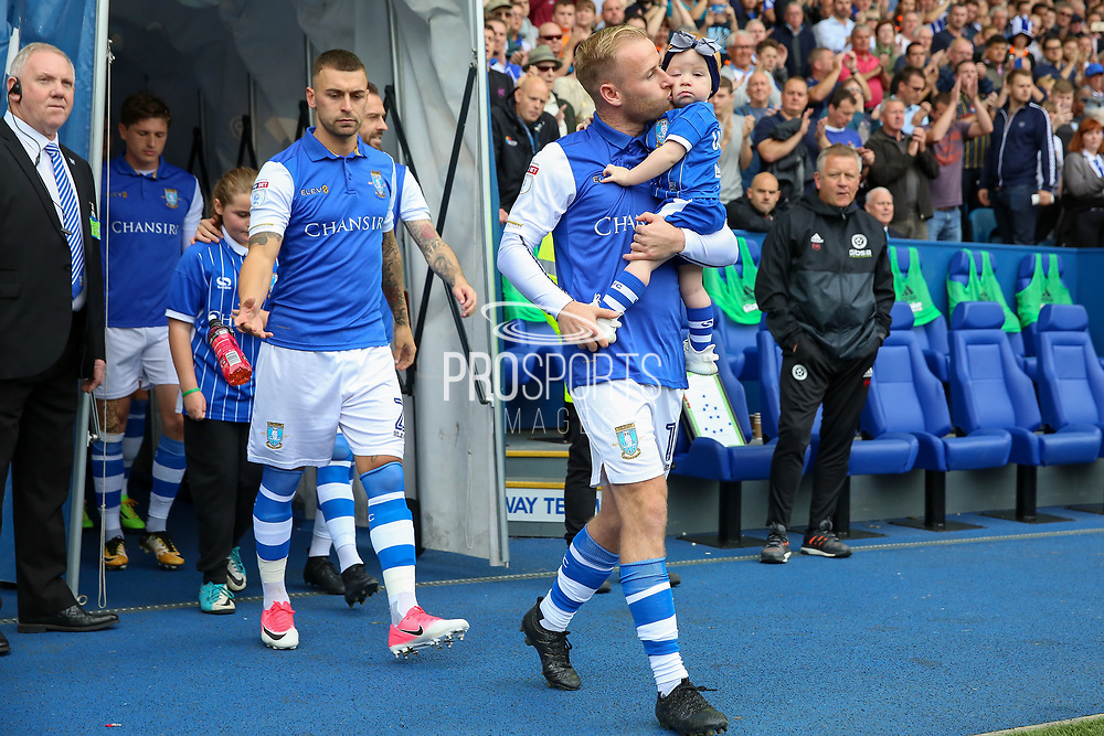Sheffield Wednesday midfielder Barry Bannan (10) with his baby during the EFL Sky Bet Championship match between Sheffield Wednesday and Sheffield Utd at Hillsborough, Sheffield, England on 24 September 2017. Photo by Phil Duncan.