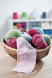 Balls of wool with knitting needle in salesroom, Bavaria, Germany