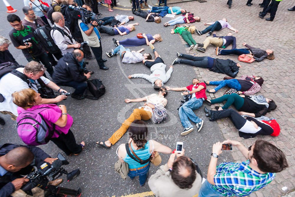 """London, July 5th 2014. Demonstrator hold a """"die-in"""" as hundreds protest near the Israeli embassy in London against the ongoing occupation and the west's support of Israel's collective punishment of Palestinians"""