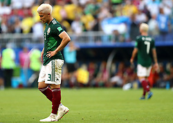 Mexico's Carlos Salcedo appears dejected after Brazil's Roberto Firmino scores his side's second goal of the game