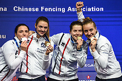 WUXI, July 27, 2018  Gold-medalists players of France celebrate during the awarding ceremony for women's sabre team competition at the Fencing World Championships in Wuxi, east China's Jiangsu Province, July 27, 2018. France beat Russia 45-35 in the final and claimed the title of the event. (Credit Image: © Li Bo/Xinhua via ZUMA Wire)