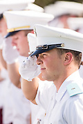 Members of the Citadel Military College corps of cadets salute during the first Friday Dress Parade on September 6, 2013 in Charleston, South Carolina. The Friday Dress Parade is a tradition at the Citadel going back to 1843.
