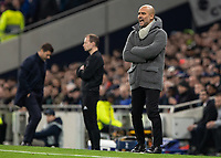 Football - 2018 / 2019 UEFA Champions League - Quarter Final , First Leg: Tottenham Hotspur vs. Manchester City<br /> <br /> Pep Guardiola, Manager of Manchester City, shouts to his team whilst head bowed Mauricio Pochettino, Manager of Tottenham FC, turns away at White Hart Lane Stadium.<br /> <br /> COLORSPORT/DANIEL BEARHAM