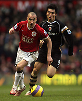 Photo: Paul Thomas.<br /> Manchester United v Charlton Athletic. The Barclays Premiership. 10/02/2007.<br /> <br /> Henrik Larsson (L) of Utd gets away from Zheng Zhi.