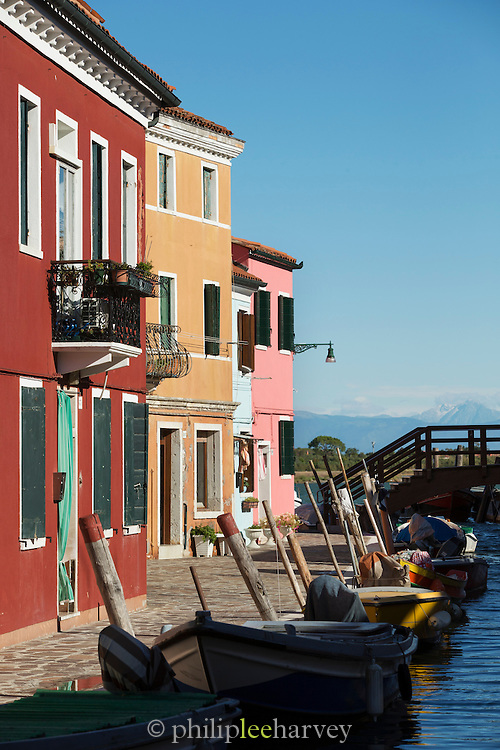Burano's Canals with the Dolomite Mountain range in the background. Island of Burano, Venice, Italy, Europe