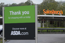 April 28, 2018 - London, HERTFORDSHIRE, UK - LONDON, UK.  Signage for an ASDA and Sainsbury's superstore are seen opposite each other in Watford, north west London.   ASDA and Sainsbury's are reported to be in negotiations for a GBP10m merger to create combined group of 2,800 stores representing over 30% of the UK grocery market. (Credit Image: © Stephen Chung/London News Pictures via ZUMA Wire)