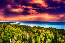 A Purple Sunset Approaches over Lake Superior Along Minnesota's North Shore. The North Shore of Lake Superior runs from Duluth, Minnesota, United States, at the southwestern end of the lake, to Thunder Bay and Nipigon, Ontario, Canada, in the north to Sault Ste. Marie, Ontario, in the east. The shore is characterized by alternating rocky cliffs and cobblestone beaches, with rolling hills and ridges covered in boreal forest inland from the lake, through which scenic rivers and waterfalls descend as they flow to Lake Superior. Americans often refer only to the Minnesota shoreline from Duluth to the international border at Grand Portage as the North Shore