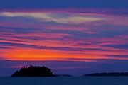 Sunset and lighthouse looking toward Sister Islands, Georgian Bay; Killbear Provincial Park<br /> Killbear Provincial Park<br /> Ontario<br /> Canada