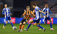 Hull City's Keane Lewis-Potter battles for the ball<br /> <br /> Photographer Dave Howarth/CameraSport<br /> <br /> The EFL Sky Bet League One - Wigan Athletic v Hull City - Wednesday 17th February 2021 - DW Stadium - Wigan<br /> <br /> World Copyright © 2021 CameraSport. All rights reserved. 43 Linden Ave. Countesthorpe. Leicester. England. LE8 5PG - Tel: +44 (0) 116 277 4147 - admin@camerasport.com - www.camerasport.com