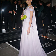 London,England,UK : 8th April 2016 : A Vip guest wearing a stunning long dress sweeping the floor attend the The Asian Awards 2016 at Grosvenor House Hotel, Park Lane, London. Photo by See Li