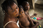 A woman and her daughter who suffers from a respiratory infection in the village of Lalo, Benin, on Friday September 14, 2007.