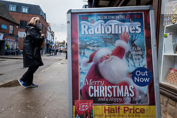 © Licensed to London News Pictures. 15/12/2020. RICKMANSWORTH, UK. A sandwich board shows the  Christmas issue of the Radio Times in Rickmansworth, Hertfordshire.  The historic town will be elevated to Tier 3 Covid Alert Level tomorrow, as part of the Three Rivers District Council area joining London and other areas of the South East as the number of coronavirus cases continues to rise. Health professionals have said that relaxing restrictions over the Christmas period will lead to increased number of Covid-19 related deaths.  Photo credit: Stephen Chung/LNP