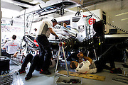 Hungarian Grand Prix 2013<br /> our best selection from Award winning Photographer Darren Heath.<br /> McLaren Mechanics work on the car <br /> ©Darren Heath/Exclusivepix