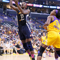 03 August 2014: Connecticut Sun forward Chiney Ogwumike (13) goes for the layup past Los Angeles Sparks forward Nneka Ogwumike (30) during the Los Angeles Sparks 70-69 victory over the Connecticut Sun, at the Staples Center, Los Angeles, California, USA.
