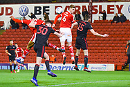Liam Lindsay of Barnsley (6) heads the ball during the EFL Sky Bet League 1 match between Barnsley and Sunderland at Oakwell, Barnsley, England on 12 March 2019.