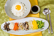 Modern version of the traditional bibimbap, a popular Korean dish that is served with warm rice mixed with a wide variety of ingredients, usually beef and vegetables. Seoul, South Korea