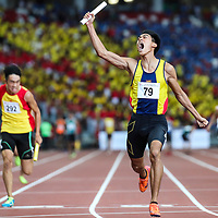Joshua Lim (#79) celebrates after anchoring Anglo-Chinese School (Independent) to win the A Division boys' 4x100m final. (Photo © Lim Yong Teck/Red Sports)