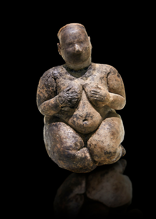 Seated terracotta goddess, probably a sign of fertility. Catalhoyuk Collections. Museum of Anatolian Civilisations, Ankara. Against a black background .<br /> <br /> If you prefer you can also buy from our ALAMY PHOTO LIBRARY  Collection visit : https://www.alamy.com/portfolio/paul-williams-funkystock/prehistoric-neolithic-art.html - Type Catalhoyuk into the LOWER SEARCH WITHIN GALLERY box. Refine search by adding background colour, place, museum etc.<br /> <br /> Visit our PREHISTORIC PLACES PHOTO COLLECTIONS for more  photos to download or buy as prints https://funkystock.photoshelter.com/gallery-collection/Prehistoric-Neolithic-Sites-Art-Artefacts-Pictures-Photos/C0000tfxw63zrUT4