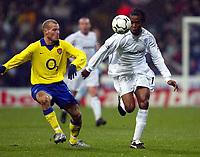 Photo. Aidan Ellis.<br />Bolton Wanderers v Arsenal.<br />FA Barclaycard Premiership.<br />20/12/2003.<br />Bolton's Ricardo Gardner and Arsenal's Freddie Ljunberg