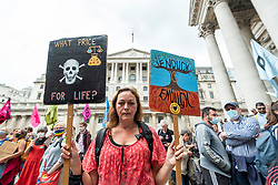 """© Licensed to London News Pictures. 27/08/2021. LONDON, UK.  A climate activist from Extinction Rebellion with signs protests outside the Bank of England in The City of London.  The event is part of the 'Impossible Rebellion' protest to """"target the root cause of the climate and ecological crisis"""" and are ongoing for two weeks until the Government agrees to stop all new fossil fuel investments.  Photo credit: Stephen Chung/LNP"""