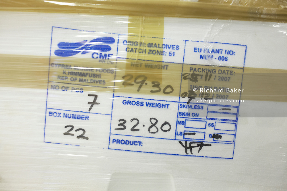 Stamped consignment details on a polystyrene box of fresh Maldives tuna held in storage at a heathrow airport warehouse