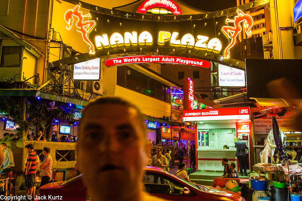 """12 JANUARY 2013 - BANGKOK, THAILAND:  The entrance to the Nana Entertainment Plaza on Sukhumvit Soi 4 in Bangkok. Prostitution in Thailand is illegal, although in practice it is tolerated and partly regulated. Prostitution is practiced openly throughout the country. The number of prostitutes is difficult to determine, estimates vary widely. Since the Vietnam War, Thailand has gained international notoriety among travelers from many countries as a sex tourism destination. One estimate published in 2003 placed the trade at US$ 4.3 billion per year or about three percent of the Thai economy. It has been suggested that at least 10% of tourist dollars may be spent on the sex trade. According to a 2001 report by the World Health Organisation: """"There are between 150,000 and 200,000 sex workers (in Thailand).""""    PHOTO BY JACK KURTZ"""