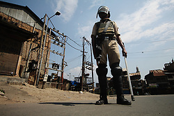 September 7, 2016 - Srinagar, Jammu and Kashmir, India - A paramilitary trooper intercepting a commuter during the curfew. The ongoing unrest has claimed more than 75 lives so far, mostly of civilians while more than 9500 have been injured, maimed and blinded. (Credit Image: © Umer Asif/Pacific Press via ZUMA Wire)