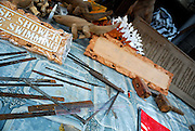 Wood carvers tools and examples of his work. Sanur, Bali, Indonesia.