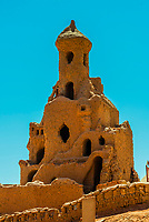 """Adobe (mudbrick) architecture built for the movie """"Journey to the West"""" near the Bezeklik Thousand Buddha Caves, Flaming Mountains, Turpan, Xinjiang Province, China."""