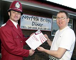 Norfolk Bridge Diner gets the Ketchup Police All Clear.<br /> Owner Mick Williams<br /> WKPC Helen Swain & KPC Sunny Hoyle<br /> Customers Paul Reeve and Mike Ombker<br /> <br /> 5th February 2004<br /> <br /> image copyright Paul David Drabble<br /> <br /> <br /> <br /> [#Beginning of Shooting Data Section]<br /> Nikon D1 <br /> <br /> 2004/02/05 10:42:29.3<br /> <br /> JPEG (8-bit) Fine<br /> <br /> Image Size:  2000 x 1312<br /> <br /> Color<br /> <br /> Lens: 17-35mm f/2.8-4<br /> <br /> Focal Length: 19mm<br /> <br /> Exposure Mode: Programmed Auto<br /> <br /> Metering Mode: Multi-Pattern<br /> <br /> 1/250 sec - f/7.6<br /> <br /> Exposure Comp.: 0 EV<br /> <br /> Sensitivity: ISO 800<br /> <br /> White Balance: Auto<br /> <br /> AF Mode: AF-S<br /> <br /> Tone Comp: Normal<br /> <br /> Flash Sync Mode: Front Curtain<br /> <br /> Auto Flash Mode: External<br /> <br /> Color Mode: <br /> <br /> Hue Adjustment: <br /> <br /> Sharpening: Normal<br /> <br /> Noise Reduction: <br /> <br /> Image Comment: <br /> <br /> [#End of Shooting Data Section]