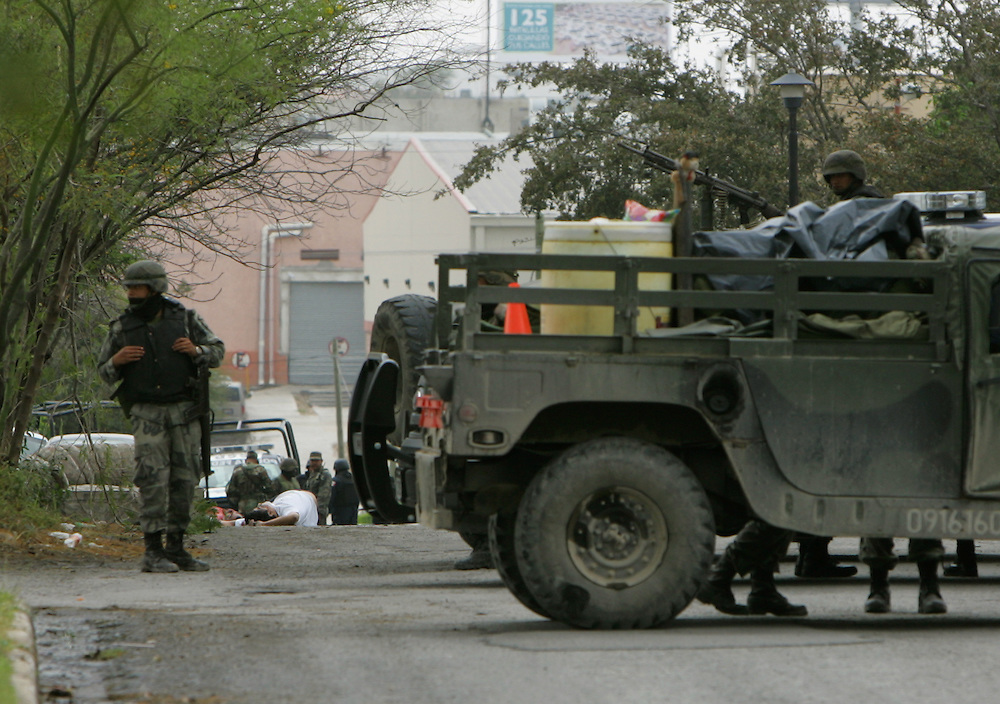 Reynosa, Tamaulipas - 17 Feb 2009 - .The bodies of 2 men lie in the street surrounded by Mexican Army soldiers in the Las Fuentes neighborhood of Reynosa on Tuesday afternoon..Photo by Alex Jones / ajones@themonitor.com