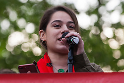 London, UK. 1st May, 2019. Elif Sarican of the Kurdish People's Assembly addresses climate protesters at a Declare A Climate Emergency Now demonstration in Parliament Square organised to coincide with a motion in the House of Commons to declare an environment and climate emergency tabled by Leader of the Opposition Jeremy Corbyn. The motion, which does not legally compel the Government to act, was passed without a vote.