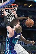 Orlando Magic forward Serge Ibaka blocks a shot by Charlotte Hornets center Cody Zeller (40) during the first half of an NBA basketball game in Orlando, Fla., Wednesday, Dec. 28, 2016. (AP Photo/Phelan M. Ebenhack)