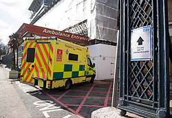© Licensed to London News Pictures. 06/03/2020. London, UK. An ambulance drives past a sign directing patients to a Coronavirus pod, at Kings College Hospital in South London. New cases of the COVID-19 strain of Coronavirus are being reported daily as the government outlines it's plans for controlling the outbreak. Photo credit: Ben Cawthra/LNP