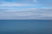 Seascape looking out over a blue sea and sky on 19th August 2021 in Mwnt, Pembrokeshire, Wales, United Kingdom.