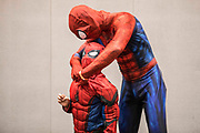 UNITED KINGDOM, London: 27 May 2018 Cosplay fans Thomas Dyke and his son Ben, aged 8, get ready before making an entrance at the MCM London Comic Con earlier today. The three day comic convention, which is held at London's ExCeL, was visited by thousands of avid cosplay fans and enthusiasts. Rick Findler / Story Picture Agency