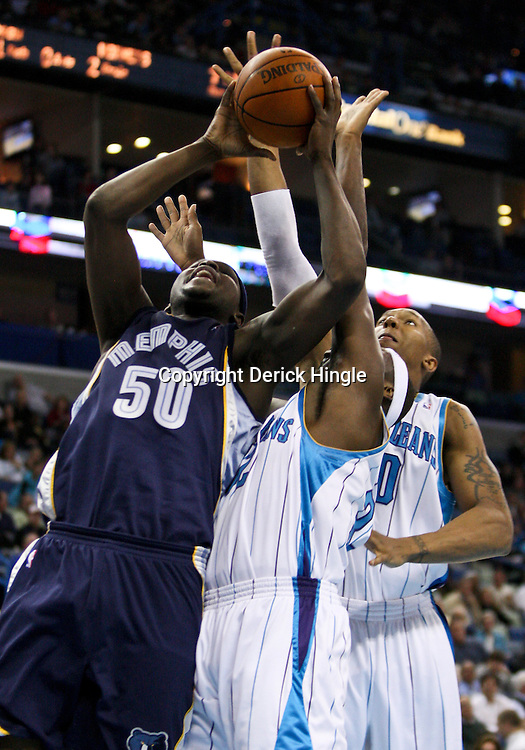 Mar 03, 2010; New Orleans, LA, USA; Memphis Grizzlies forward Zach Randolph (50) is defended by New Orleans Hornets forward Julian Wright (left) as forward David West (right) blocks the shot from behind during the first half at the New Orleans Arena. Mandatory Credit: Derick E. Hingle-US PRESSWIRE