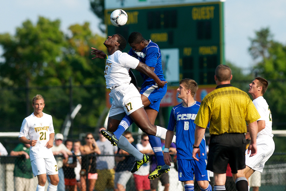 Catamounts forward D.J. Elder (17) fights for the header during the men's soccer game between the Central Connecticut State University Blue Devils and the Vermont Catamounts at Virtue Field on Friday afternoon September 7, 2012 in Burlington, Vermont.