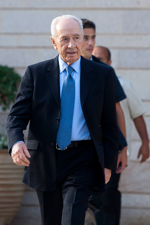 """Israeli President Shimon Peres arrives at the President's Award for Volunteerism ceremony, held at the president's residence in Jerusalem on August 9, 2010. The """"Presidential Award for Volunteerism"""" is the most prestigious award in the field of volunteering, given each year by the President of the State of Israel to 12 winners. The aim of this award is to recognize the work done by individuals and groups in all sectors of the populations and to encourage the spirit of voluntarism in Israel's society."""