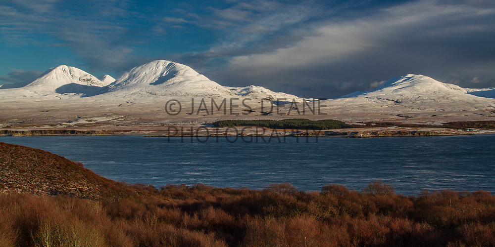 Viewed from the Bunnahabhain Road, the Paps of Jura with a covering of snow