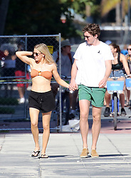 EXCLUSIVE: *NO WEB UNTIL 1500 EST 12TH JAN* Singer Ellie Goulding wears a bandeau bikini top as she takes a walk with husband Caspar Jopling in Miami on New Year's Day. 01 Jan 2020 Pictured: Ellie Goulding. Photo credit: MEGA TheMegaAgency.com +1 888 505 6342