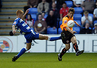 Picture: Henry Browne.<br /> Date: 02/04/2005.<br /> Reading v Sheffield United Coca-Cola Championship.<br /> United's Jon Harley clears past Reading's Steve Sidwell.