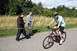 Walkers and cyclist at Sence Valley Forest Park, Leicestershire, site of former opencast colliery