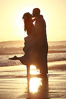 20 September 2008:  Mr. Rabin Rajkumar and Carrie Rollman married at tower 9 in Huntington Beach, CA on the sand at sunset infront of 180 friends and family south of the pier. .