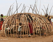 Building a Daasanach tribe hut Photographed in the Omo Valley, Ethiopia