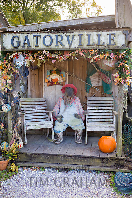 Alligator character at Gatorville Cajan village by Mississippi River near Union in Louisiana, USA