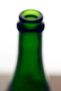 out of focus champagne bottle neck